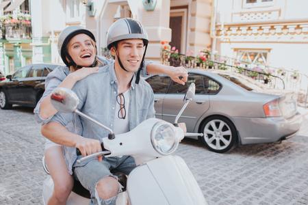 Happy girl is riding on bike with her boyfriend