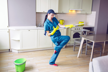 Funny worker dancing in kitchen.