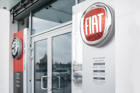 Picture of Fiat dealer store with emblem at front door. It is clean and has some miracle effect. Editoriali