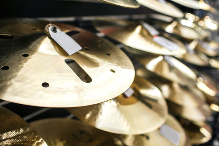 Close up of many splash cymbal. They stand one upon another.