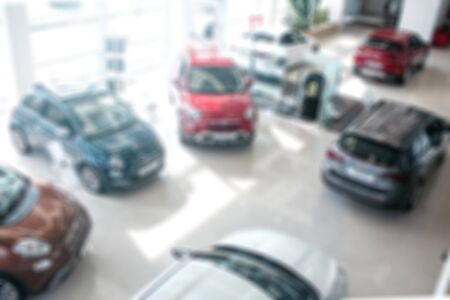 Kiev, Ukraine - September 11, 2018. Unclear picture of cars with different colours. They are in one room with glass walls. It is sunny and bright inside