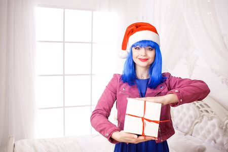 Positive nice young woman doll Holds white box present in hands. Stock fotó