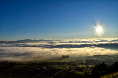 natur: Municipality of Spain under a sea of fog. Stock Photo