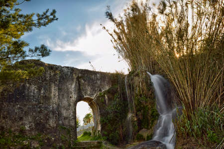 adapted: Remains of a Roman aqueduct that was later adapted to serve as flour mills. Stock Photo