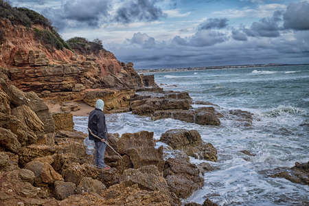 crustaceans: Shellfish craft tries to access molluscs and crustaceans from the coast struggling with the storm. Stock Photo