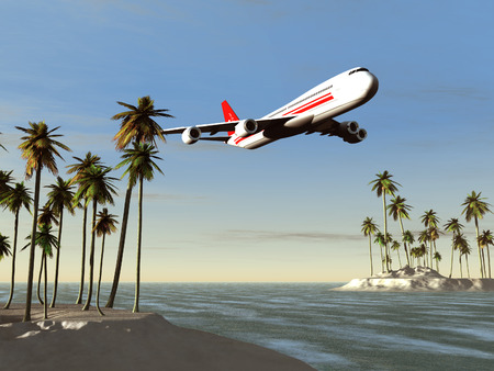 Airliner flying over a tropical area Stock Photo