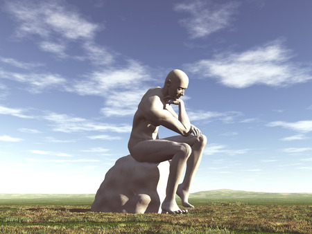 Sculpture of a thinker in a field