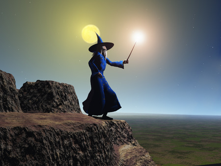 supernatural power: Wizard using his wand at the edge of a cliff Stock Photo