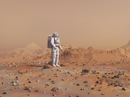 colonization: Astronaut walking on the surface of Mars Stock Photo