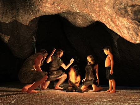 Cave Dwellers Gathered around a campfire Stockfoto