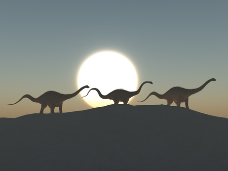 Three dinosaurs diplodocus at dawn Stock Photo