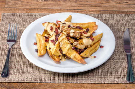 fried potato with cheddar and bacon. Stok Fotoğraf