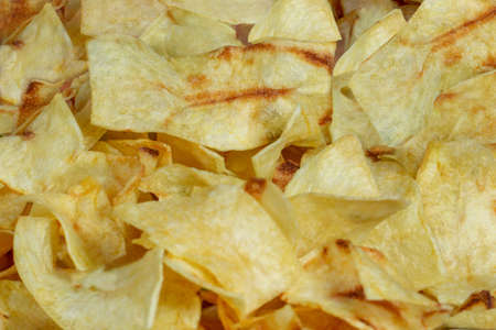 crispy potato chips snack texture background top view.