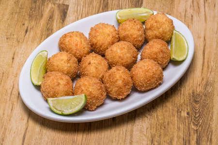 salt cod fritters, in portuguese it is called bolinho de bacalhau.