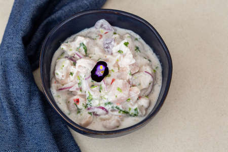 Delicious ceviche served in blue bowl.