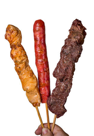 Assorted steak skewers on white background. Zdjęcie Seryjne