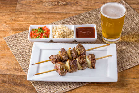 meat skewers on wooden table.