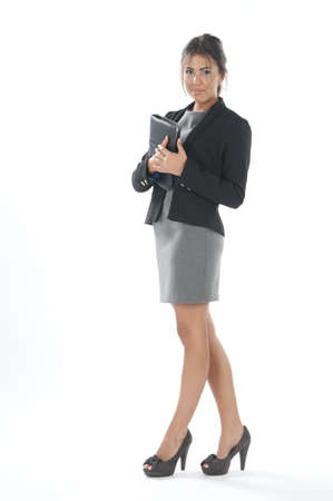 Self confident female young business executive with notebook looking at camera Stock Photo