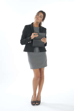 Self confident female young business executive looking at camera
