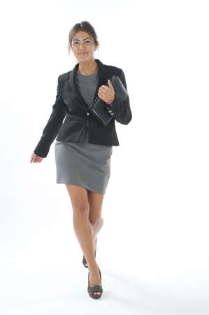 account executives: Self confident female young business executive with smiling face, looking at camera Stock Photo