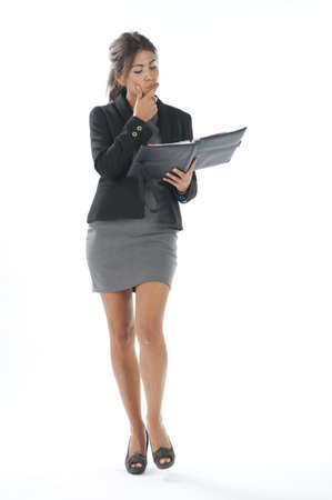 Self confident female young business executive looking to her notebook. photo