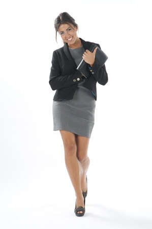 Self confident female young business executive with notebook, looking at camera Stock Photo - 14429501