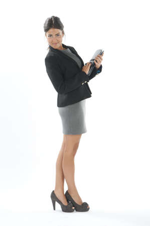 up skirt: Self confident female young business executive with notebook, looking at camera. Stock Photo