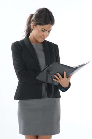 Female young business executive looking to her notebook. Stock Photo - 14429860