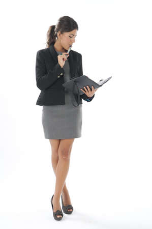Female young business executive looking at her notebook. Stock Photo - 14429485