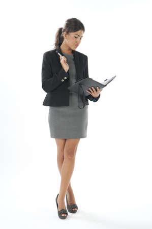 attractiveness: Female young business executive looking organizing her agenda.