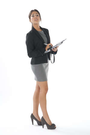 Female young business executive looking for something. Stock Photo - 14429469