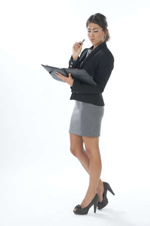 account executive: Serious female young business executive looking to her notebook. Stock Photo