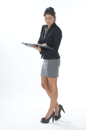 Self confident female young business executive writing . Stock Photo - 14429579