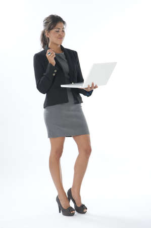 Surprised female young business executive looking at her laptop.