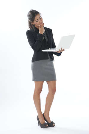 Worried female young business executive looking at her laptop. Stock Photo - 14429680
