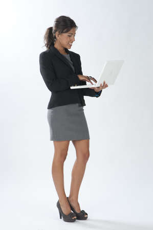 account executives: Self confident female young business executive looking at her laptop.