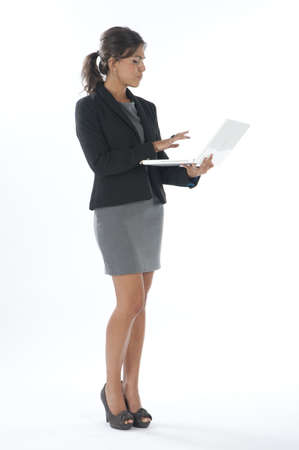 Female young business executive typing on her laptop. Stock Photo - 14429521