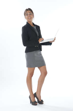 Happy female young business executive holding laptop. Stock Photo - 14429512
