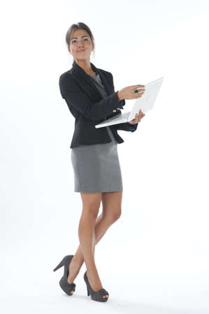 Female young business executive looking at camera holding laptop. Stock Photo - 14429550
