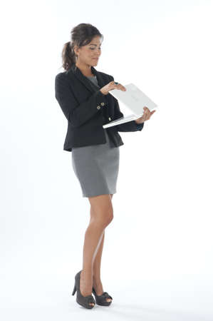 Female young business executive looking at laptop. photo