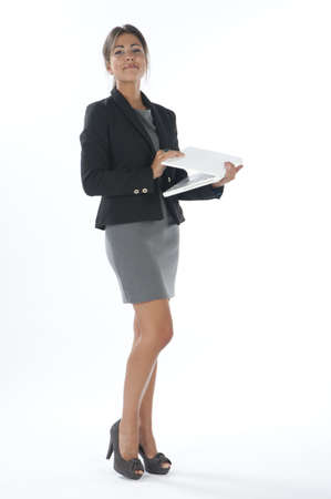 account executive: Self confident female young business executive closing laptop. Stock Photo