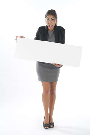 Surprised young business woman, holding sign on white background.