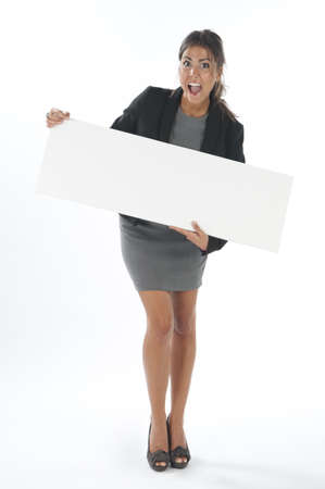 Surprised and happy young business woman, holding sign on white background.