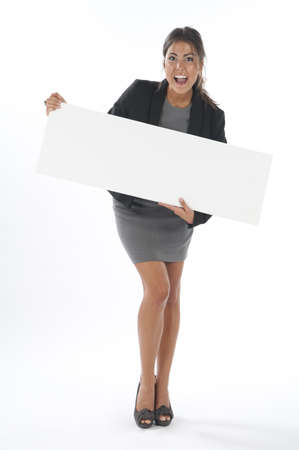 Enthusiastic young business woman, holding sign on white background. Stock Photo
