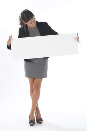 business costume: Young business woman, lookin at sign on white background