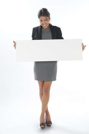 attractiveness: Happy young business woman, holding sign on white background.