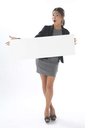 account executives: Surprised young business woman, holding sign on white background.