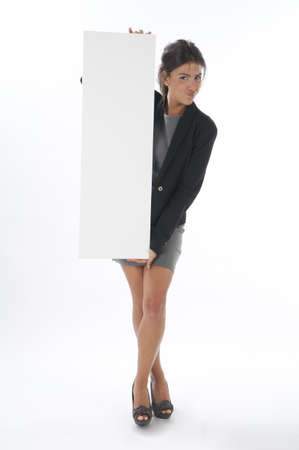 Self confident young business woman, holding sign on white background. photo