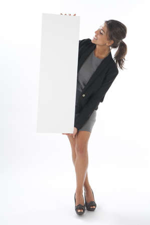 Happy young business woman, holding sign on white background.