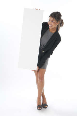 Happy young business woman, holding sign on white background, looking at camera. photo